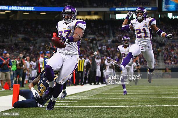 Everson Griffen of the Minnesota Vikings scores a touchdown after incepting a pass against the St Louis Rams at the Edward Jones Dome on December 16...