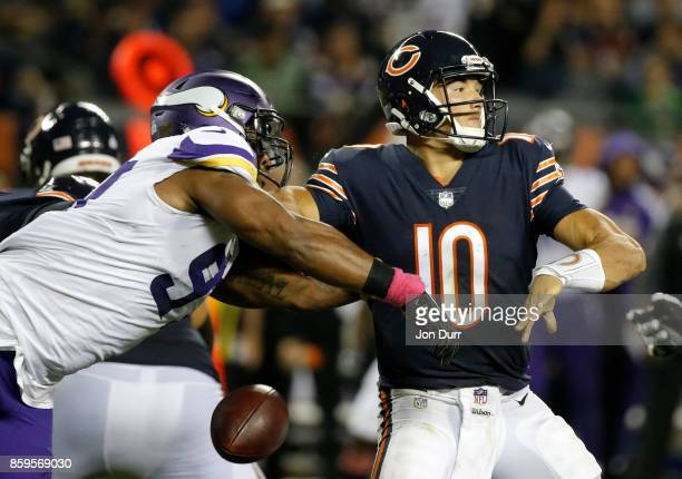 Everson Griffen of the Minnesota Vikings strips the football from quarterback Mitchell Trubisky of the Chicago Bears in the second quarter at Soldier...
