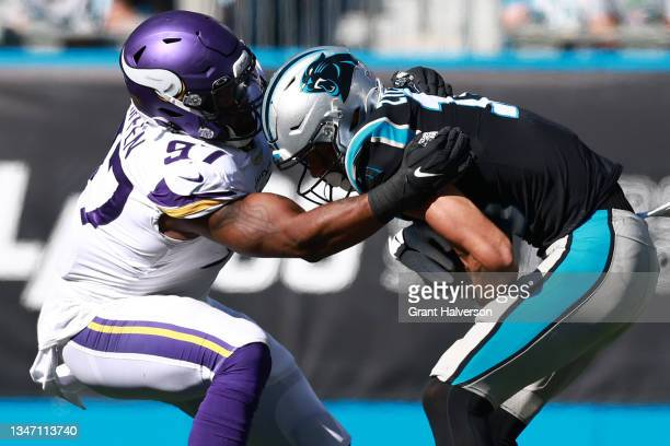 Everson Griffen of the Minnesota Vikings tackles Brandon Zylstra of the Carolina Panthers during the third quarter at Bank of America Stadium on...
