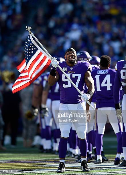 Everson Griffen of the Minnesota Vikings waves a flag before the game against the St Louis Rams on November 8 2015 at TCF Bank Stadium in Minneapolis...