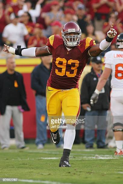Everson Griffen of the USC Trojans celebrates a fumble recovery against the Oregon State Beavers on October 24 2009 at the Los Angeles Coliseum in...