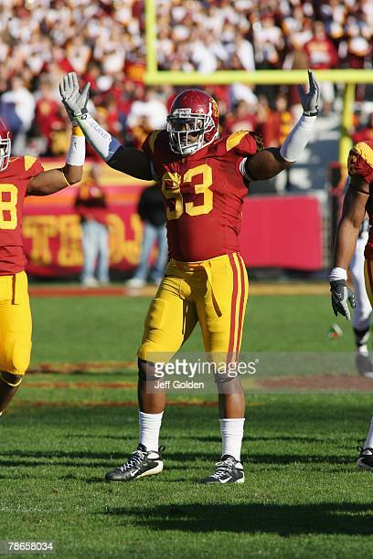 Everson Griffen of the USC Trojans raises his arms encouraging the fans for noise against the UCLA Bruins on December 1 2007 at the Los Angeles...