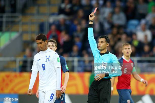 Everson Lopez of Honduras is shown a red card by match referee Muhammad Bin Jahari during the 2019 FIFA U20 World Cup group C match between Norway...
