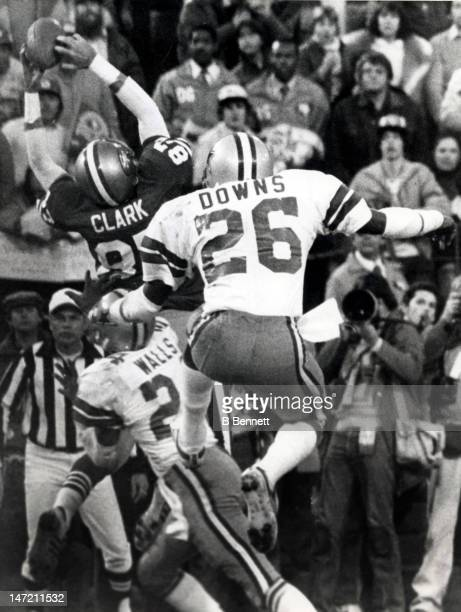 Everson Walls of the Dallas Cowboys is caught out of position as Dwight Clark of the San Francisco 49ers leaps to receive a 6yard catch of...