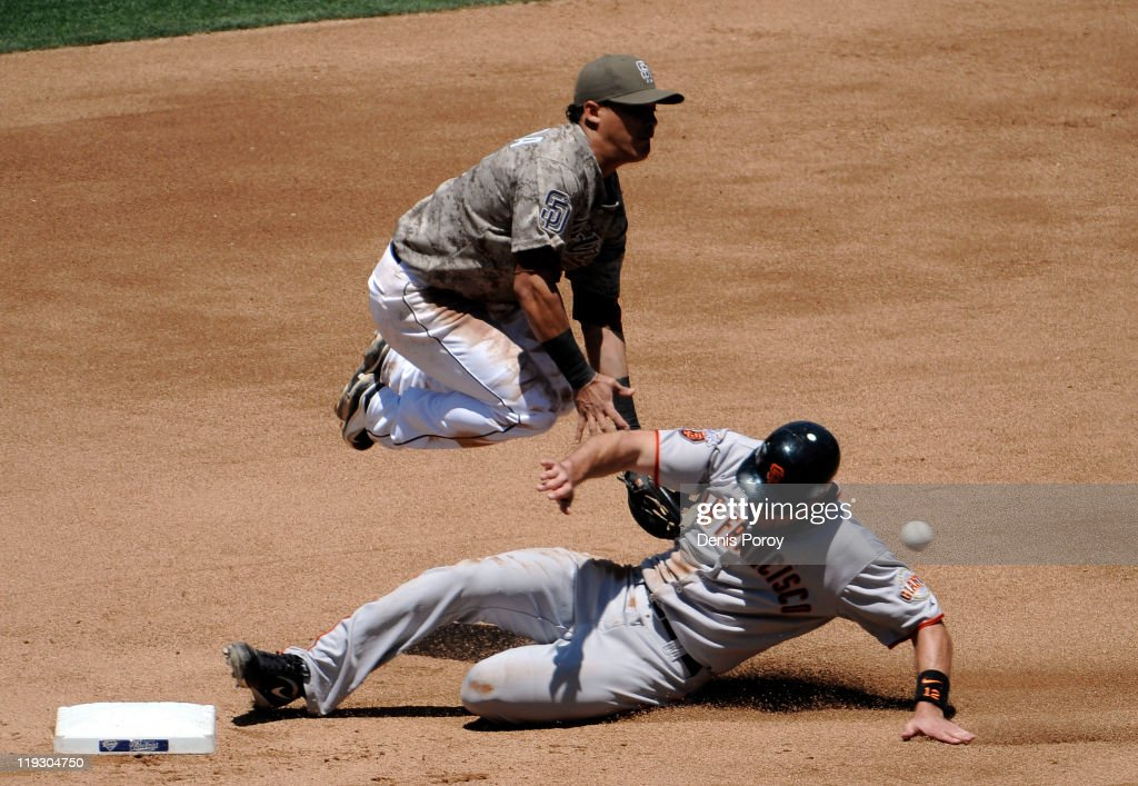 Everth Cabrera #2 of the San Diego Padres can't field the ball as Nate Schierholtz #12 of the San Francisco Giants steals second base during the fourth inning of a baseball game at Petco Park on July 17, 2011 in San Diego, California.