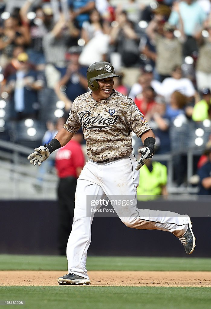 Everth Cabrera #2 of the San Diego Padres celebrates after hitting a walk-off single during the tenth inning of a baseball game against the Atlanta Braves at Petco Park August 3, 2014 in San Diego, California.