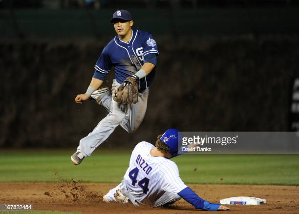 Everth Cabrera of the San Diego Padres forces out Anthony Rizzo of the Chicago Cubs during the seventh inning on April 30, 2013 at Wrigley Field in...