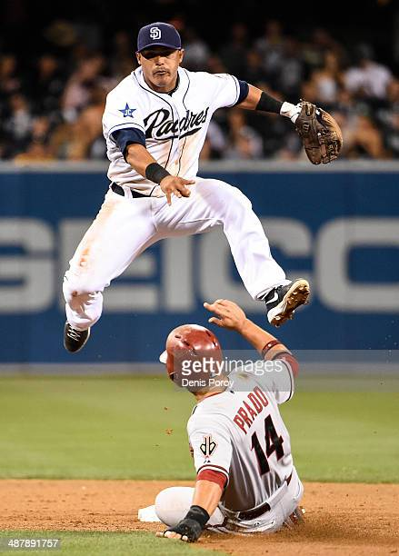 Everth Cabrera of the San Diego Padres jumps over Martin Prado of the Arizona Diamondbacks as he turns a double play during the eighth inning of a...