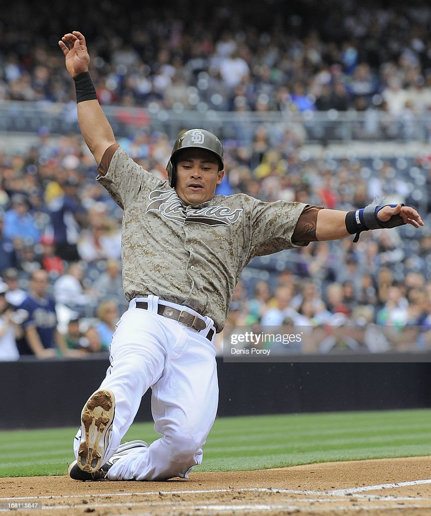 Everth Cabrera #2 of the San Diego Padres slides as he scores during the first inning of a baseball game against the Arizona Diamondbacks at Petco Park on May 5, 2013 in San Diego, California.