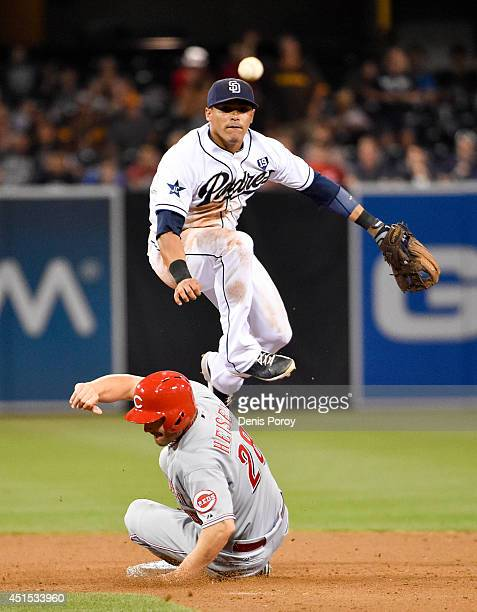 Everth Cabrera of the San Diego Padres throws over Chris Heisey of the Cincinnati Reds as he turns a double play to get the final out during the...