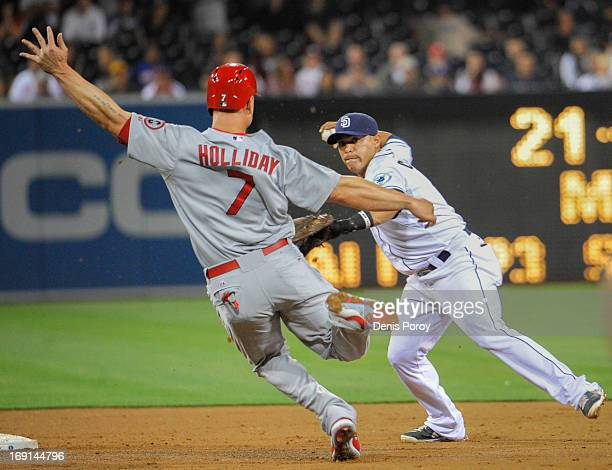 Everth Cabrera of the San Diego Padres throws over Matt Holliday of the St Louis Cardinals as he turns a double play during the third inning of a...