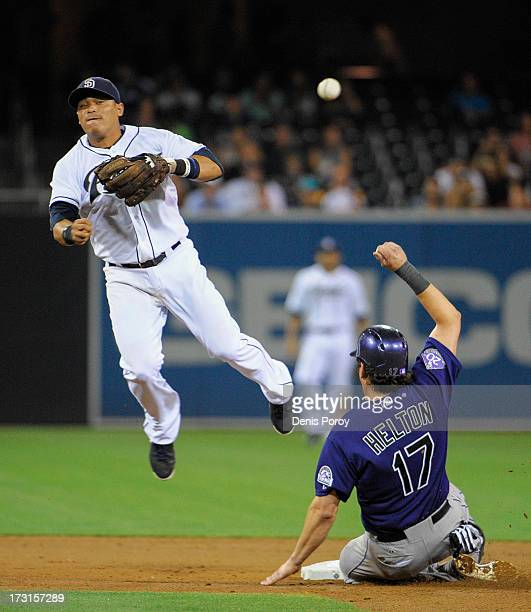 Everth Cabrera of the San Diego Padres throws over Todd Helton of the Colorado Rockies as he tries to turn double play during the sixth inning of a...