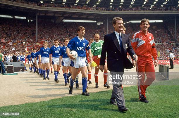 Everton and Liverpool are led out by their managers Colin Harvey and Kenny Dalglish prior to the FA Cup final against Everton at Wembley Stadium in...