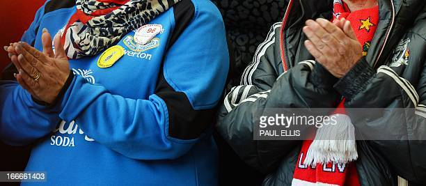 Everton and Liverpool fans sit together during a memorial service at Liverpool FC's Anfield football ground in Liverpool northwest England on April...
