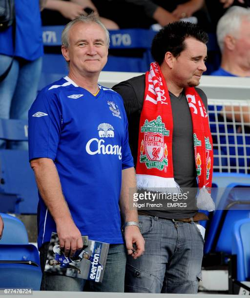 Everton and Liverpool fans stand side by side before the derby game at Goodison Park