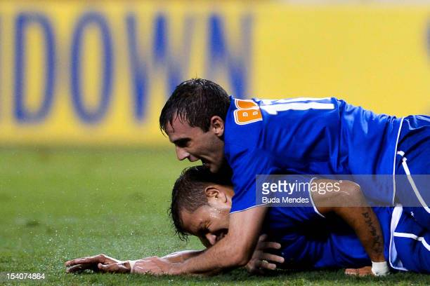 Everton and Montillo of Cruzeiro celebrate a scored goal during a match between Flamengo and Cruzeiro as part of the Brazilian Serie A Championship...