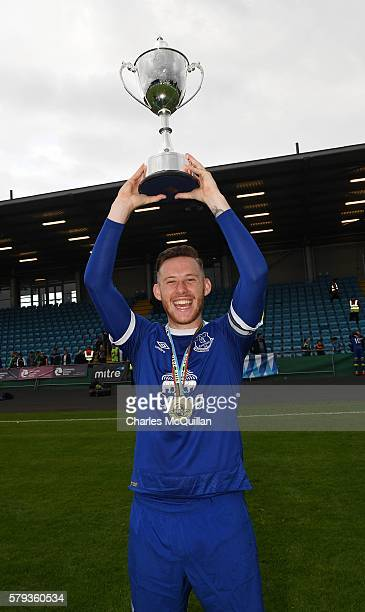 Everton captain Gethin Jones celebrates with the trophy after the Super Cup NI under 21 final at Ballymena Showgrounds on July 23 2016 in Ballymena...