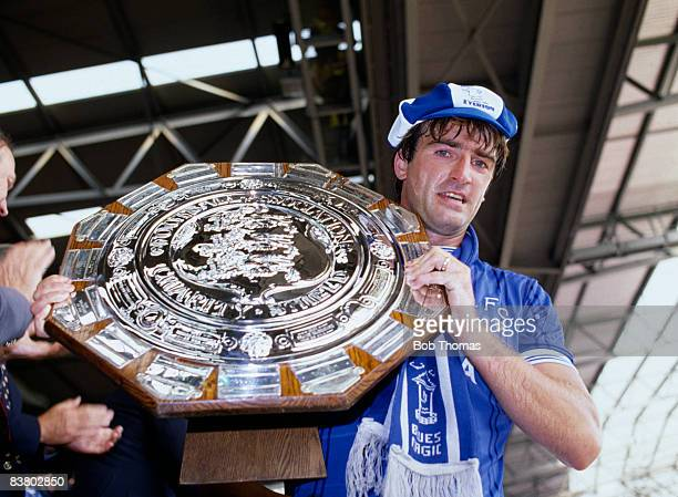 Everton captain Kevin Ratcliffe holding the FA Charity Shield after their 10 victory over Liverpool at Wembley Stadium 18th August 1984