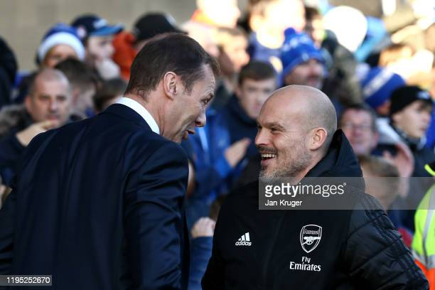 Everton Caretaker manager Duncan Ferguson chats with Interim Manager of Arsenal Freddie Ljungberg prior to kick off during the Premier League match...