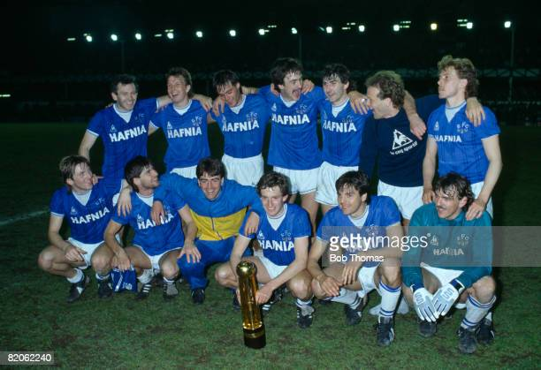 Everton celebrate with the Canon First Division Championship trophy after their match against West Ham United at Goodsion Park May 8th 1985 Everton...