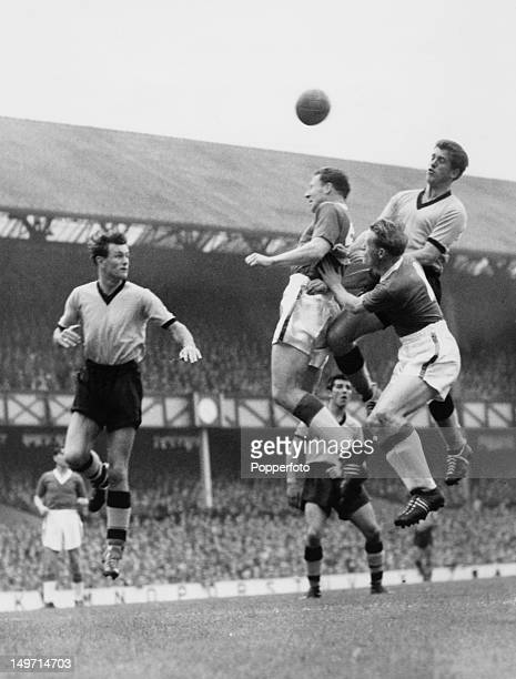 Everton centrehalf Tommy Jones supported by teammate Ken Birch clears a dangerous situation as Peter Broadbent of Wolves goes up with them during an...
