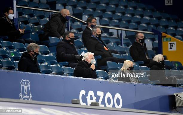 Everton Chairman Bill Kenwright watches from the stands wearing a mask during the Premier League match between Everton and Leeds United at Goodison...