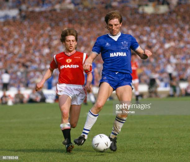 Everton defender Gary Stevens is chased by Manchester United winger Jesper Olsen during the FA Cup Final at Wembley Stadium 18th May 1985 Manchester...