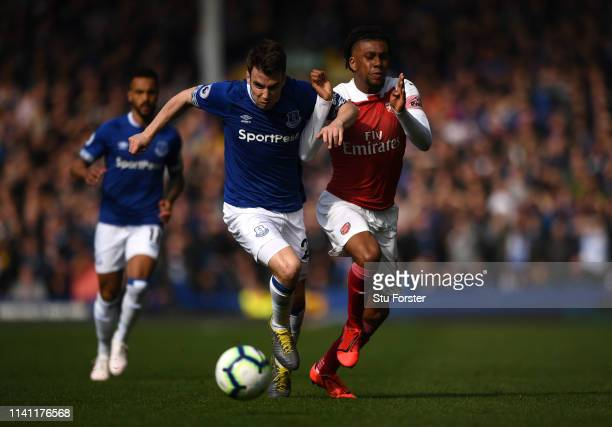Everton defender Seamus Coleman holds off the chalenge of Arsenal player Alex Iwobi during the Premier League match between Everton FC and Arsenal FC...