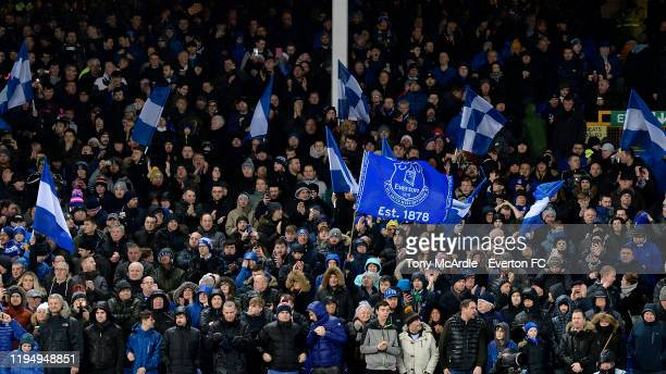 Everton fans and flags in the Gwladys Street Stand at Goodison Park before the Carabao Cup Quarter Final match between Everton and Leicester City at...