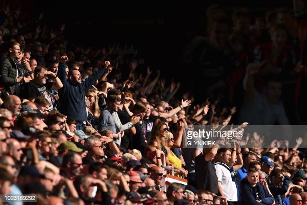 Everton fans are seen in the crowd during the English Premier League football match between Bournemouth and Everton at the Vitality Stadium in...