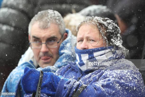 Everton fans brave the snow during the Premier League match between Stoke City and Everton at Bet365 Stadium on March 17 2018 in Stoke on Trent...