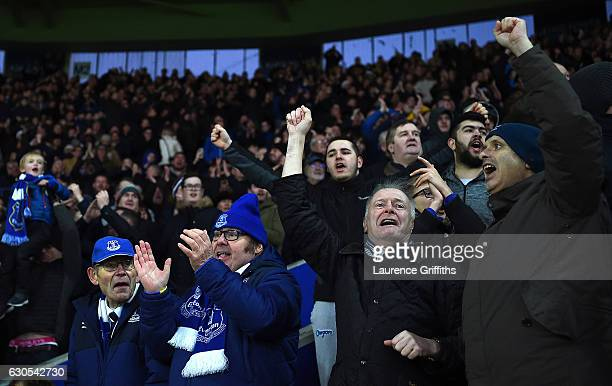 Everton fans celebrate after Kevin Mirallas of Everton scores the opening goal during the Premier League match between Leicester City and Everton at...