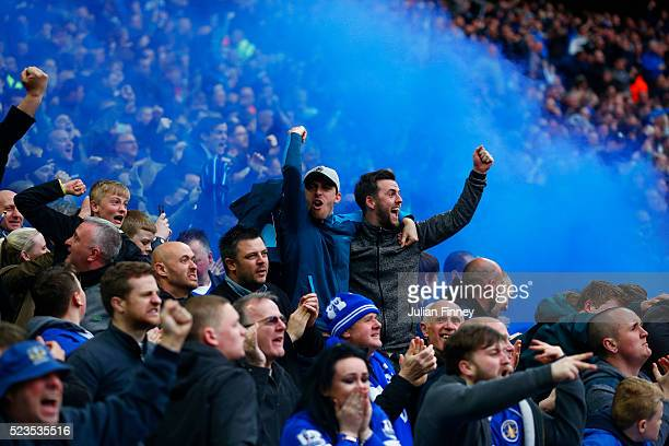 Everton fans celebrate Chris Smalling of Manchester United's own goal by lighting a flare during The Emirates FA Cup semi final match between Everton...