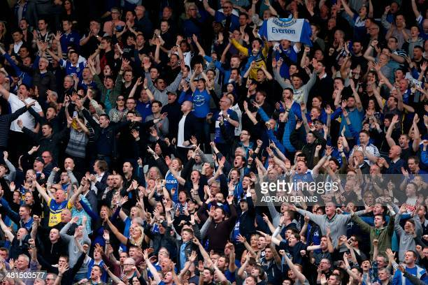 Everton fans celebrate during the English Premier League football match between Fulham and Everton at Craven Cottage in London on March 30 2014...