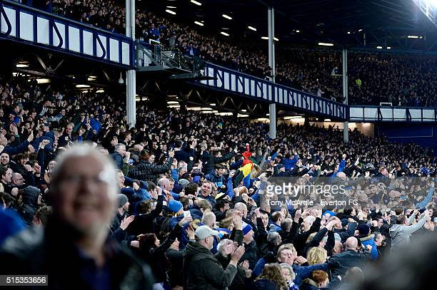 Everton fans cheer during The Emirates FA Cup Sixth Round match between Everton and Chelsea at Goodison Park on March 12 2016 in Liverpool England