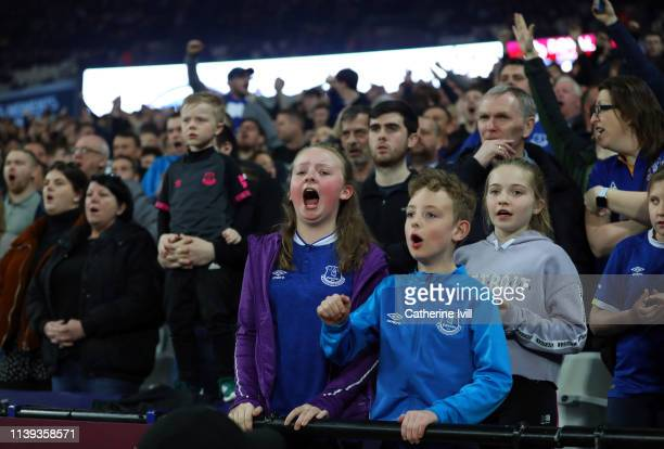 Everton fans cheer on their team during the Premier League match between West Ham United and Everton FC at London Stadium on March 30 2019 in London...