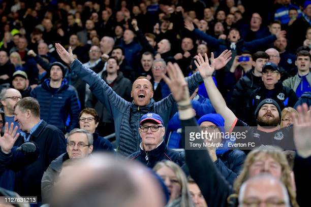 Everton fans cheer their team during the Premier League match between Cardiff City and Everton at The Cardiff City Stadium on February 26 2019 in...