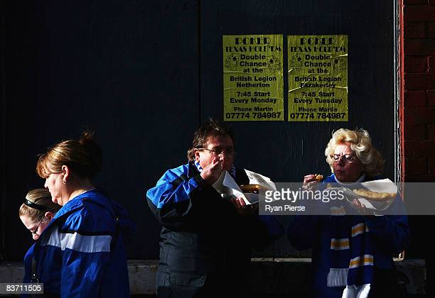 Everton fans eat fish and chips outside the ground before the Barclays Premier League match between Everton and Middlesbrough at Goodison Park on...