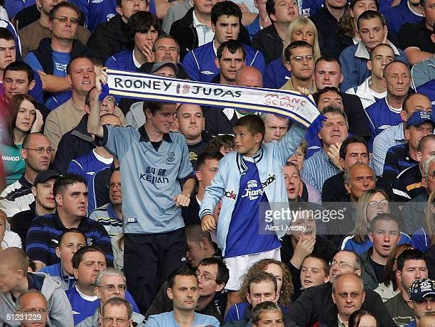 Everton fans hold up a banner protesting against Wayne Rooney during the Barclays Premiership match between Everton and West Bromwich Albion at...