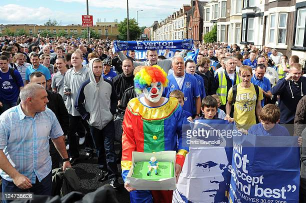 Everton fans protest against chairman Bill Kenwright prior to the Barclays Premier League match between Everton and Aston Villa at Goodison Park on...