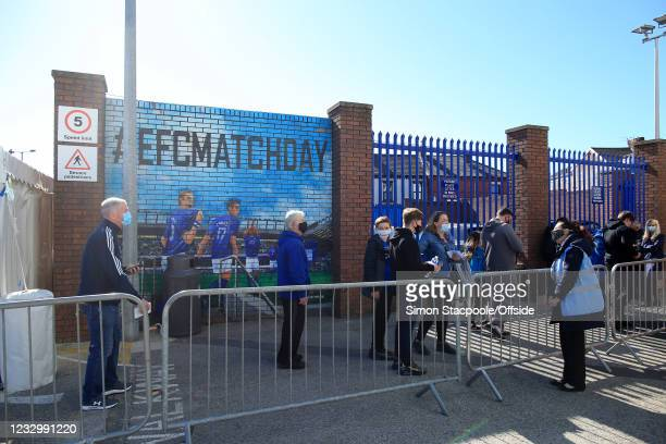 Everton fans queue up to enter the stadium during the Premier League match between Everton and Wolverhampton Wanderers at Goodison Park on May 19,...