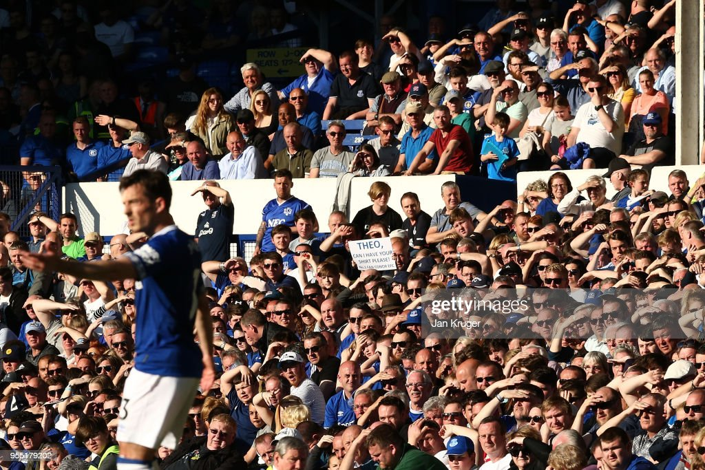 Everton fans shield their eyes during the Premier League match between Everton and Southampton at Goodison Park on May 5, 2018 in Liverpool, England.