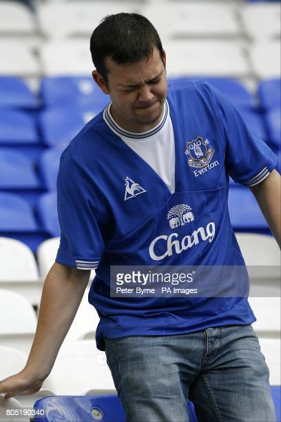 Everton fans sit dejected in the stands