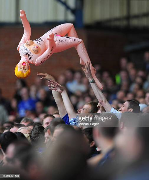 Everton fans throw an inflatable doll in reference to allegations surrounding Wayne Rooney of Manchester United during the Barclays Premier League...