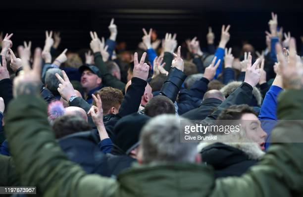 Everton fans turn their backs on the Liverpool fans as they sing 'You'll Never Walk Alone' prior to the FA Cup Third Round match between Liverpool...