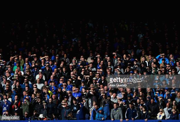 Everton fans watch the action during the Premier League match between Everton and Burnley at Goodison Park on April 15 2017 in Liverpool England