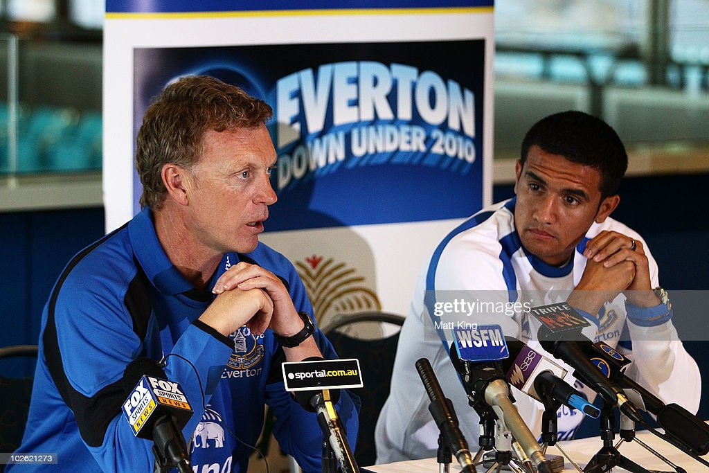 Everton FC manager David Moyes (L) talks to the media as Tim Cahill (R) looks on during an Everton FC press conference at ANZ Stadium on July 5, 2010 in Sydney, Australia.