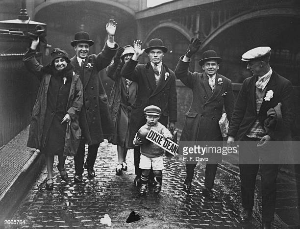 Everton FC Supporters and their young mascot who is holding a Dixie Dean sign arrive at London's Euston Station to see the 4th round FA Cup tie match...