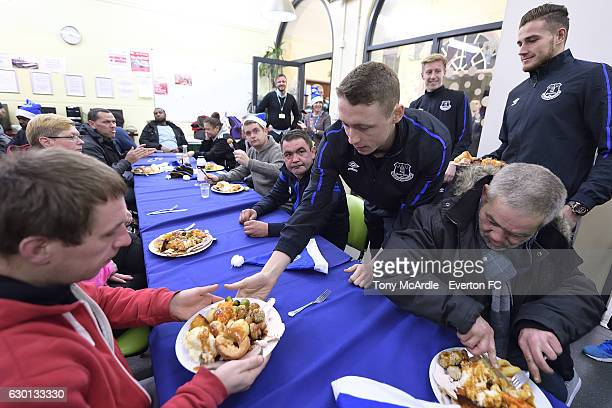 Everton FC U23 squad serve Christmas dinner at The Whitechapel Centre for homeless people Liverpool on December 2 2016 in Liverpool England