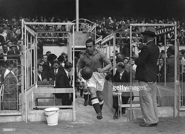 Everton Football Club captain Dixie Dean leads his team out for a match against Arsenal FC at Highbury in London